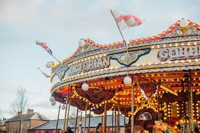 children riding merry-go-round during day victorian zoom background