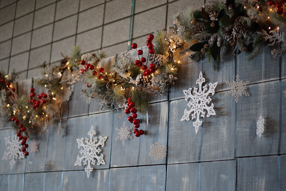 silver snowflakes, red baubles, and Christmas decorations on wall
