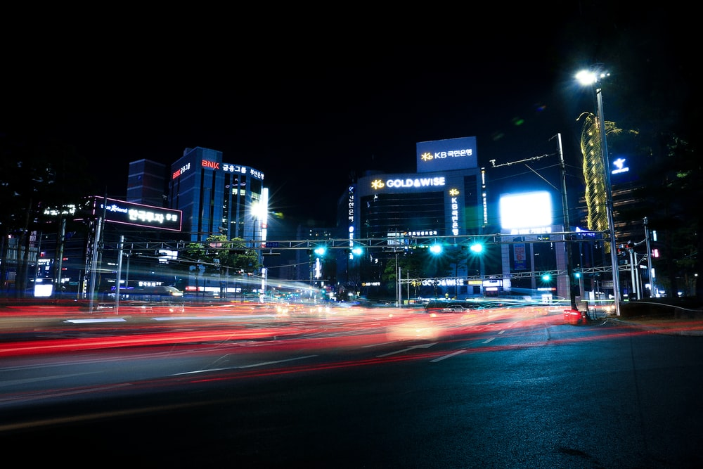 buildings near road during nighttime
