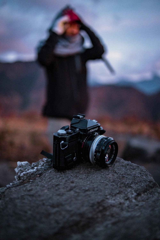selective focus photography of black a silver DSLR camera