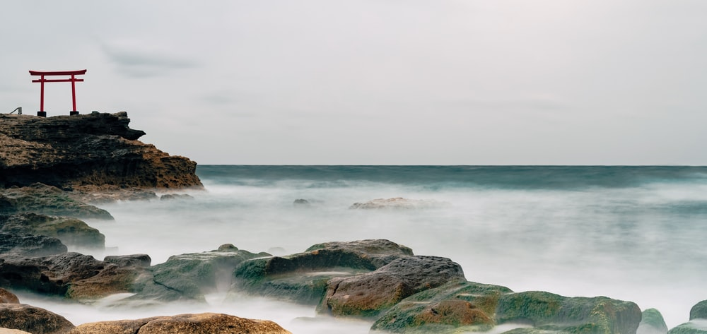 time-lapse photography of waves splashing on rocks