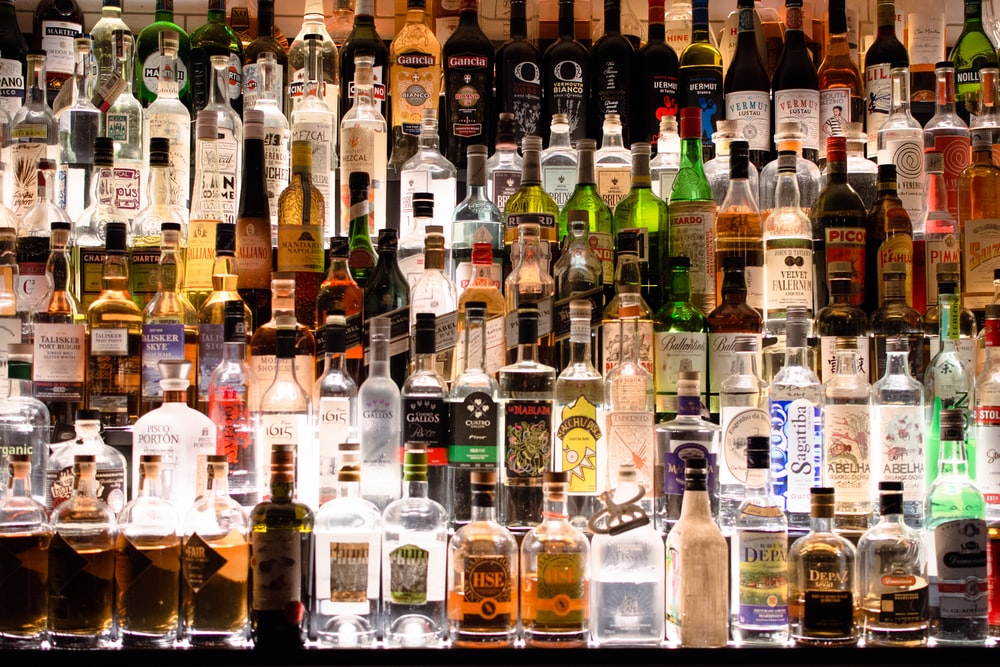 assorted liquor, wines, and whisky on display