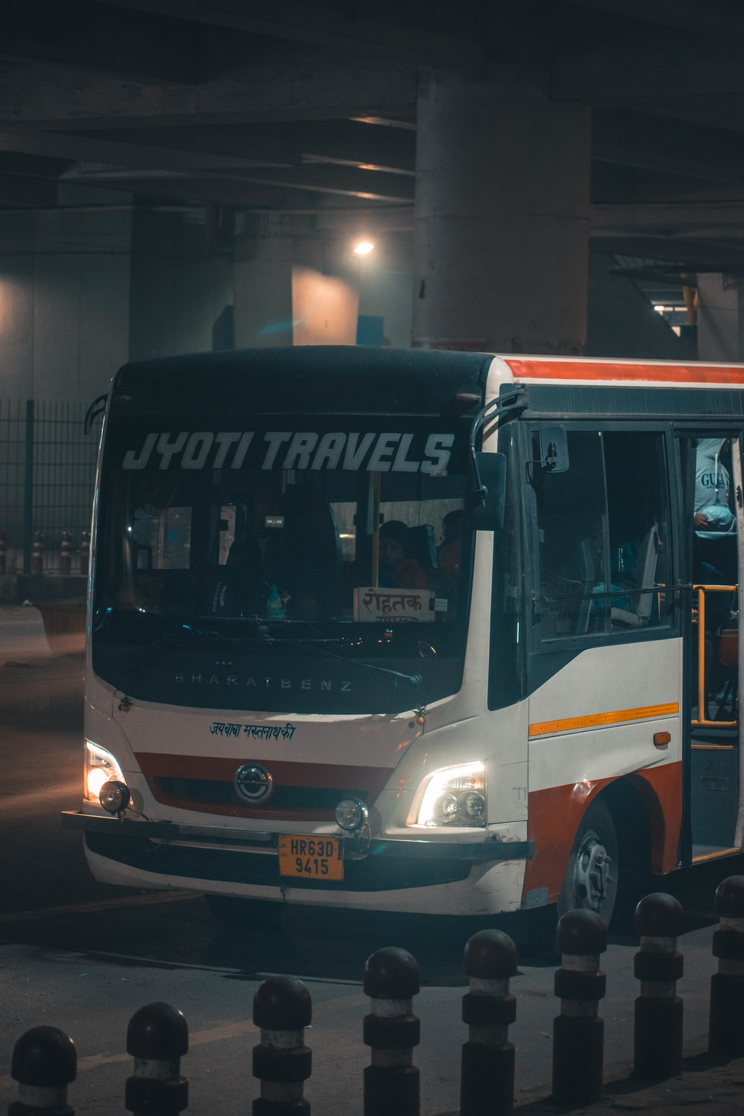 The local bus driving through the cold and chilly nights of the city