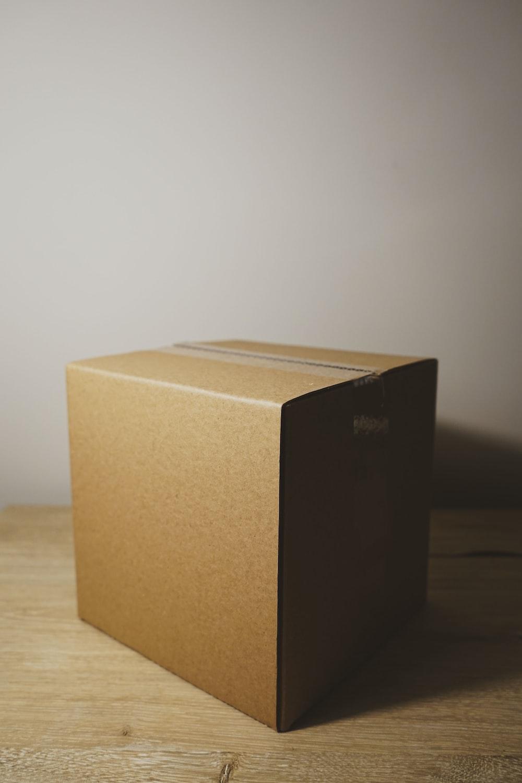 shallow focus photo of brown cardboard box