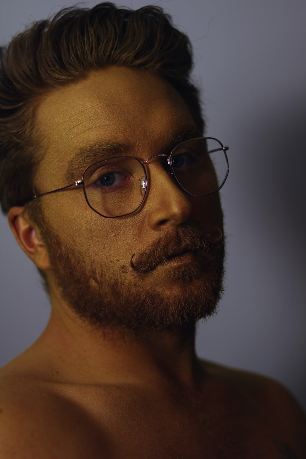 shallow focus photo of man wearing eyeglasses