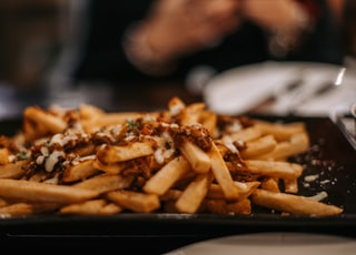 shallow focus photo of French fries