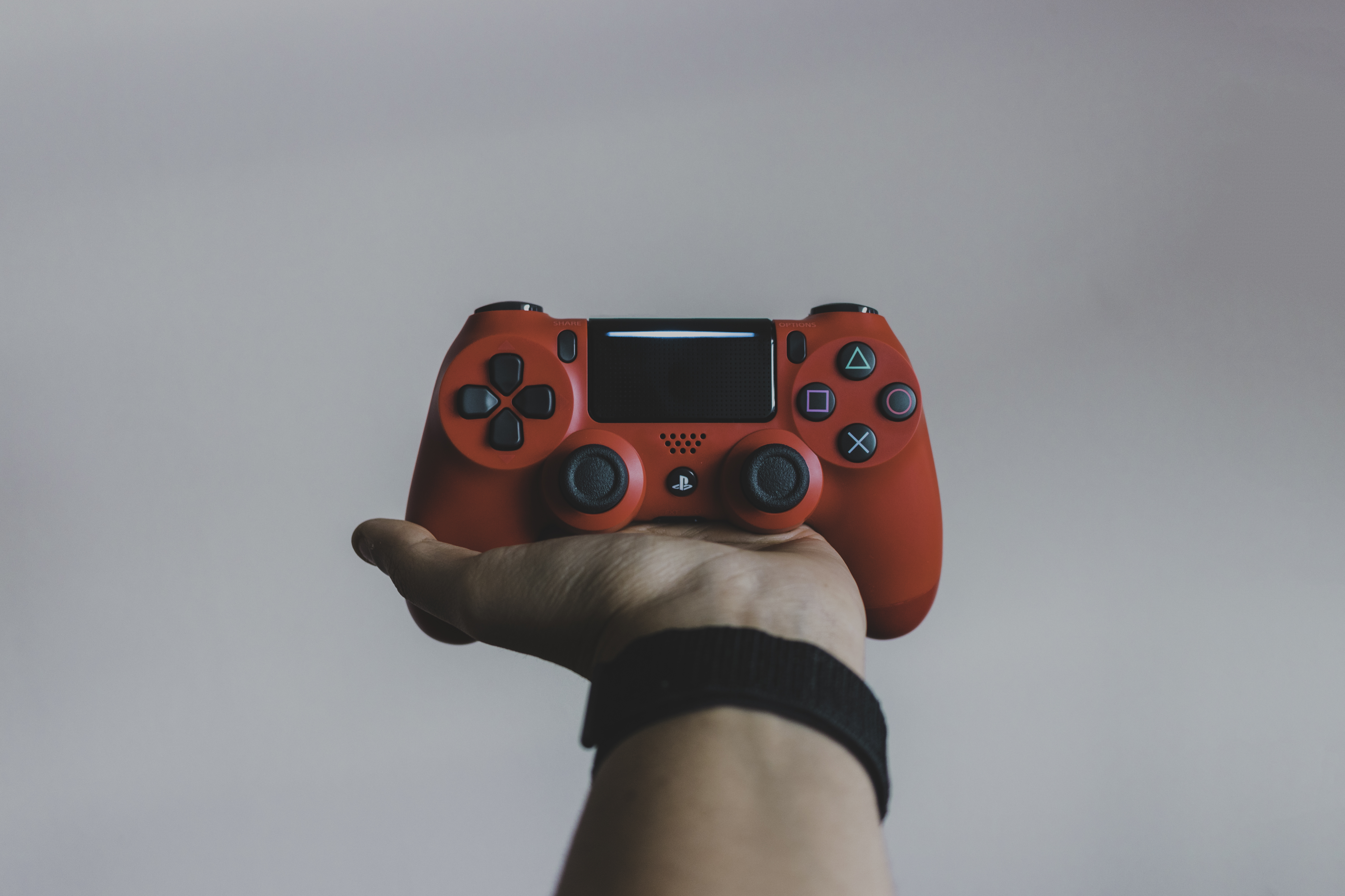 red Sony PS DualShock 4