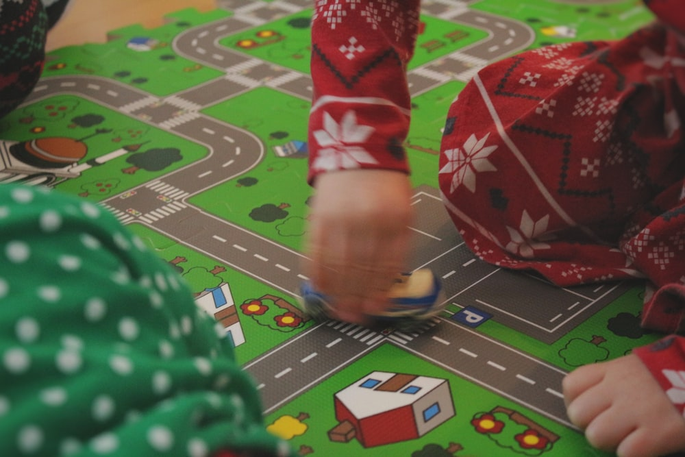 child playing on a train mat