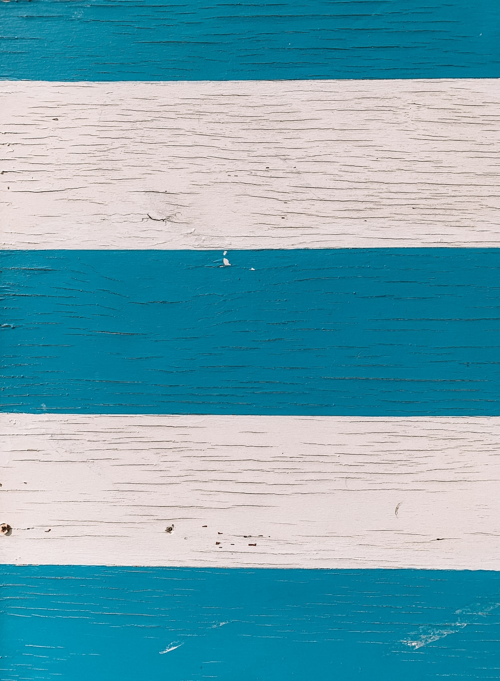 white and teal stripe surface