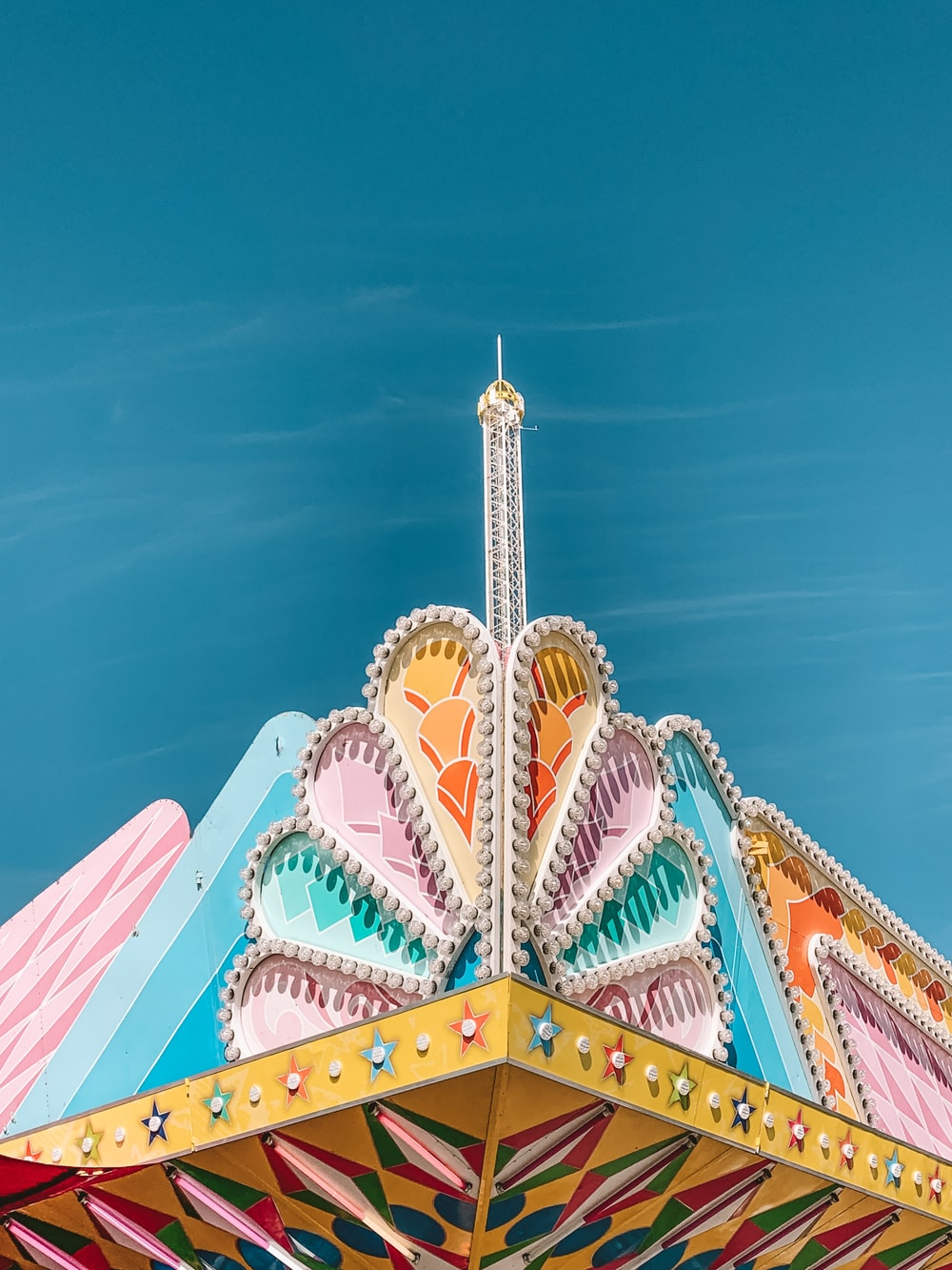 low-angle photography of multicolored building structure under blue sky