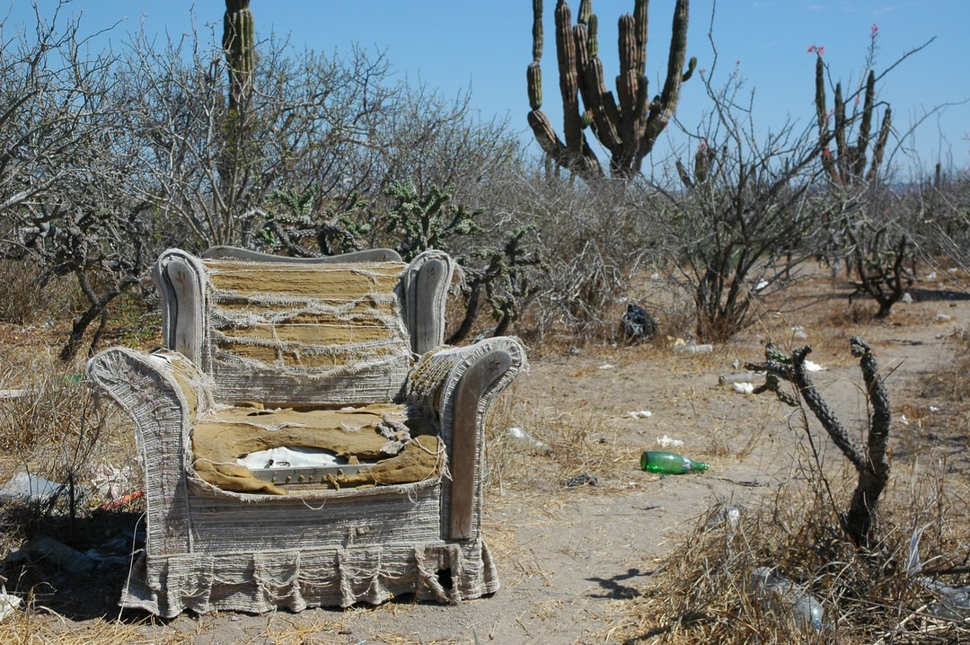 Armchair philosophy; All the comforts of home, roadside worship area, worn out armchair abandoned in the desert, near La Paz, Baja California Sur, Mexico