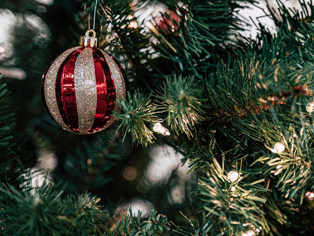 red and gray bauble on Christmas tree