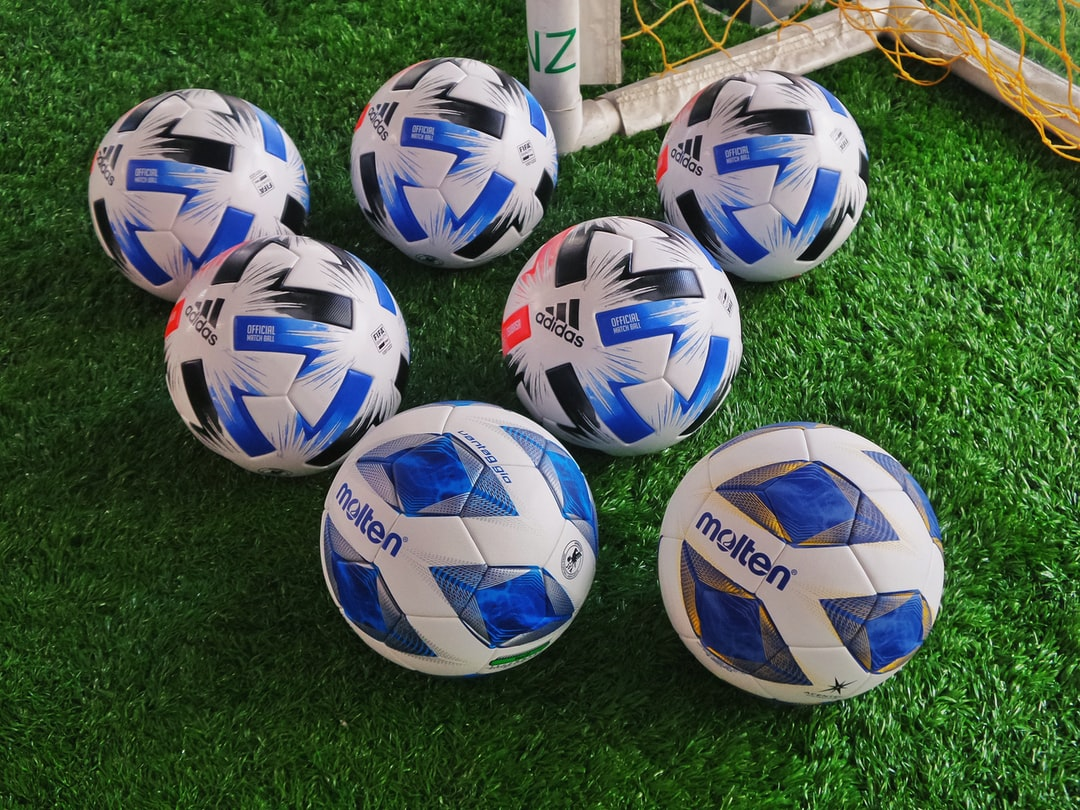 Soccer balls on artificial turf - What are five aside soccer rules?