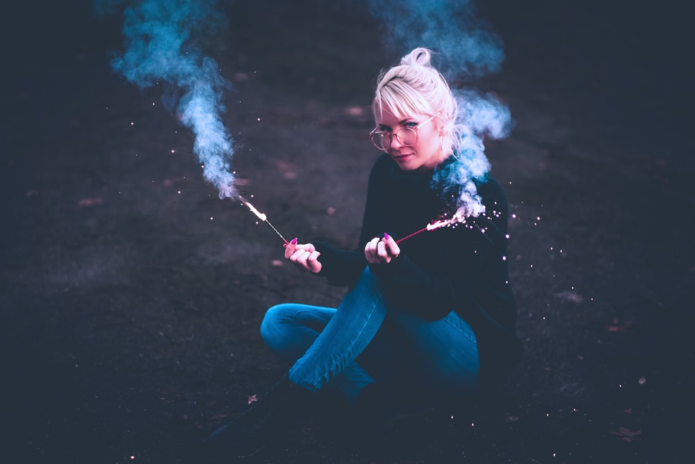 woman holding fireworks