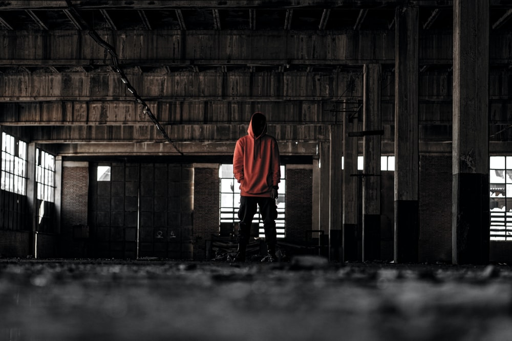 person standing inside abandoned building