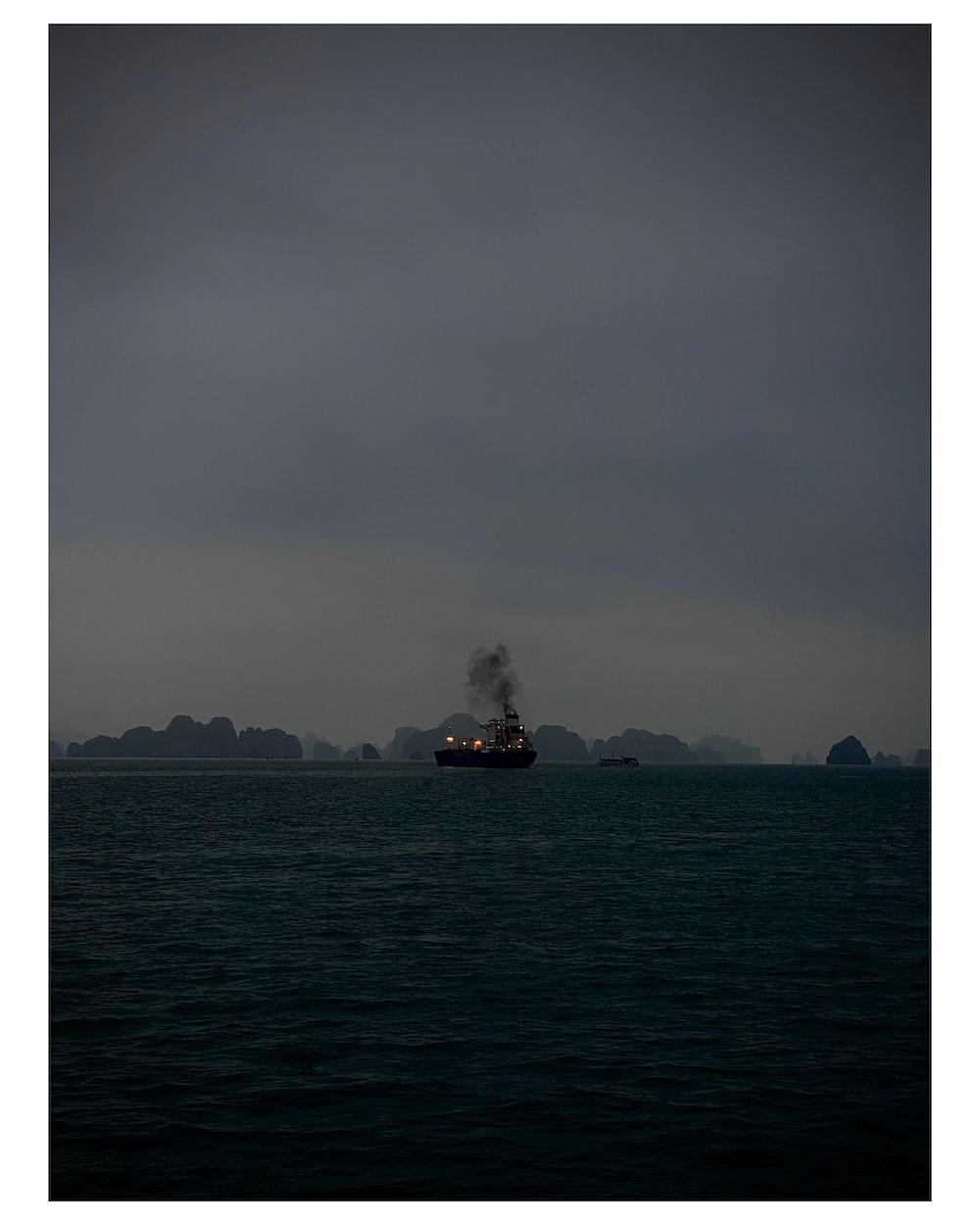 ship in sea under gray sky