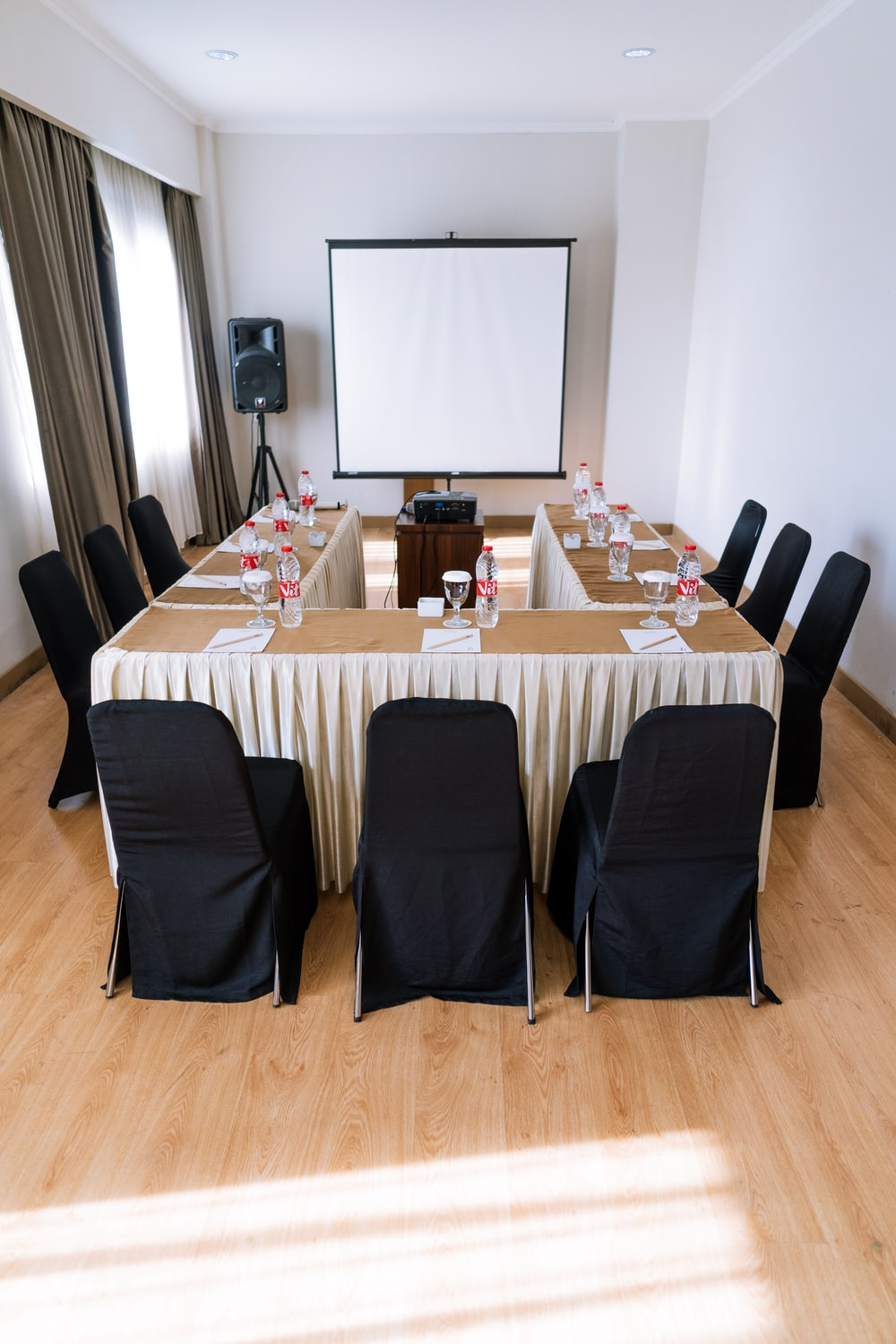 empty chairs inside room with projector canvas