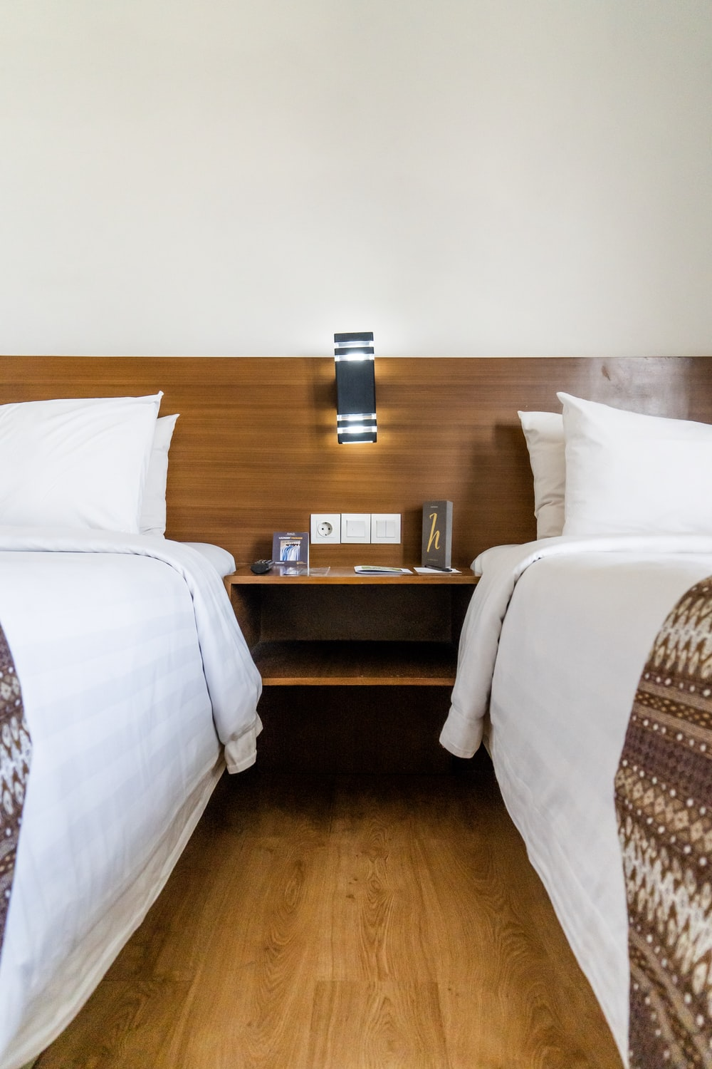 two beds inside room