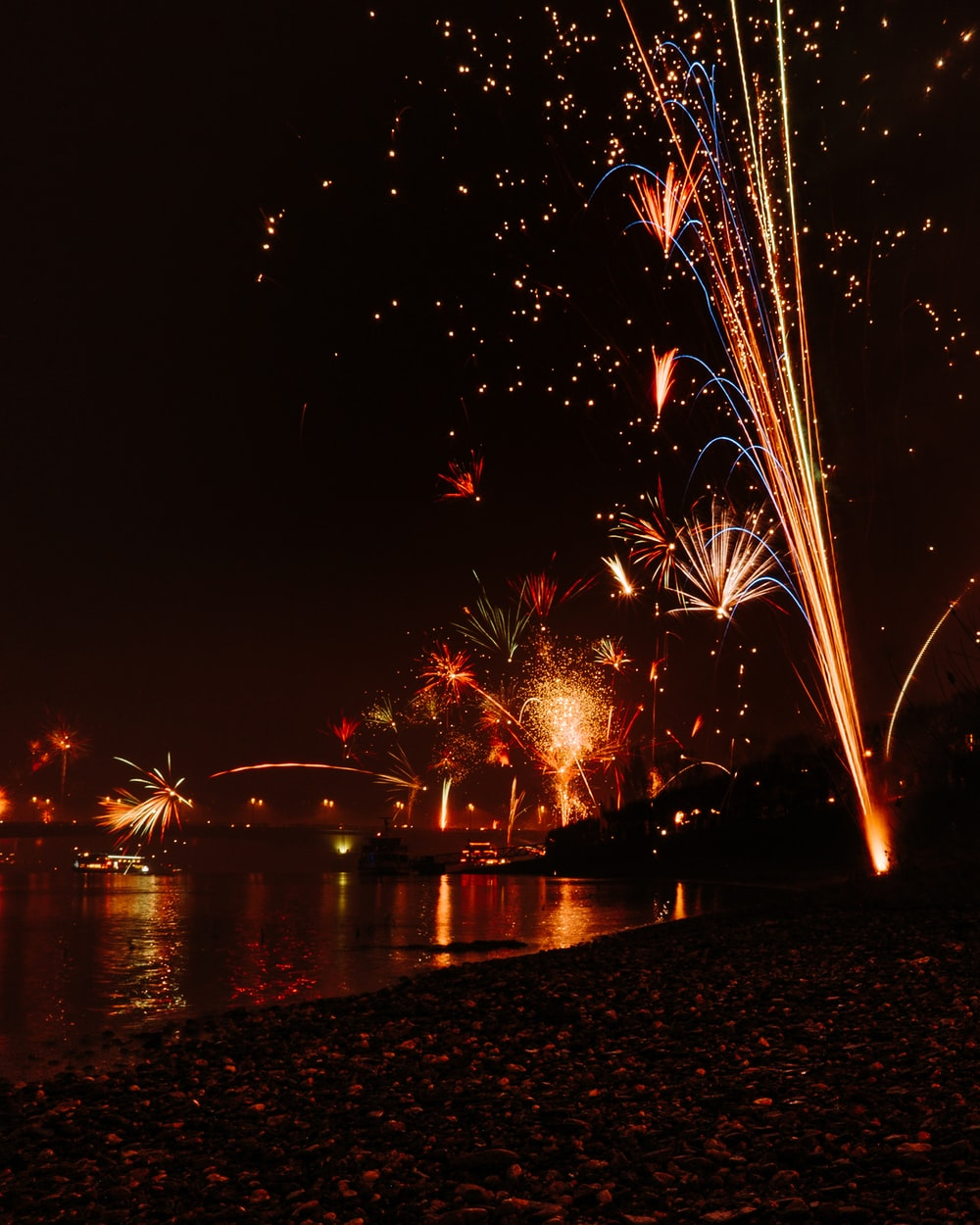 time-lapse photography of fireworks bursting in the sky during nighttime