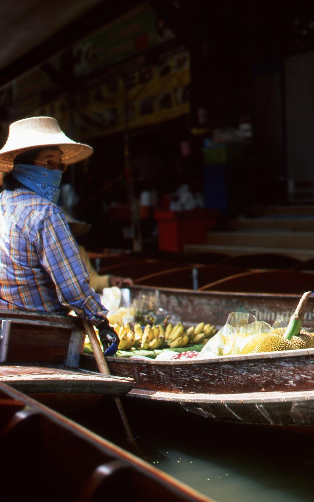 woman riding a boat market