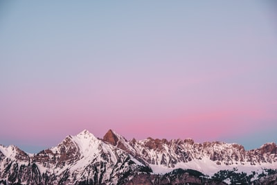 Lovely sunset behind a snowy mountain in Flums Switzerland
