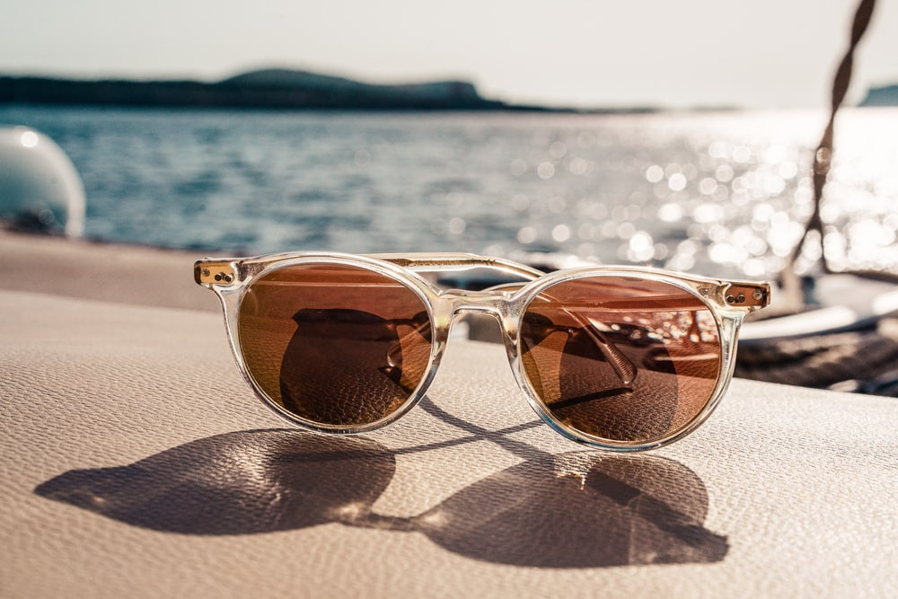 white framed brown lens sunglasses