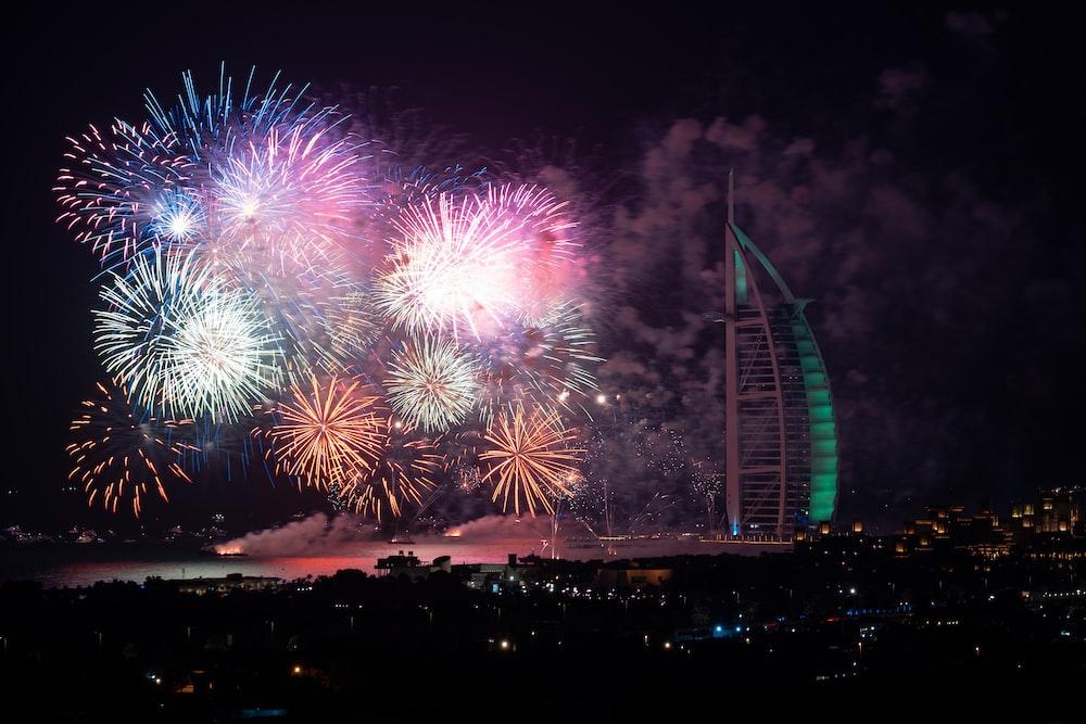 Fireworks display near Burj Al Arab building at night time