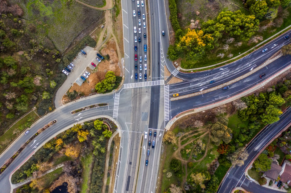 aerial photography of vehicles passing by an intersection road