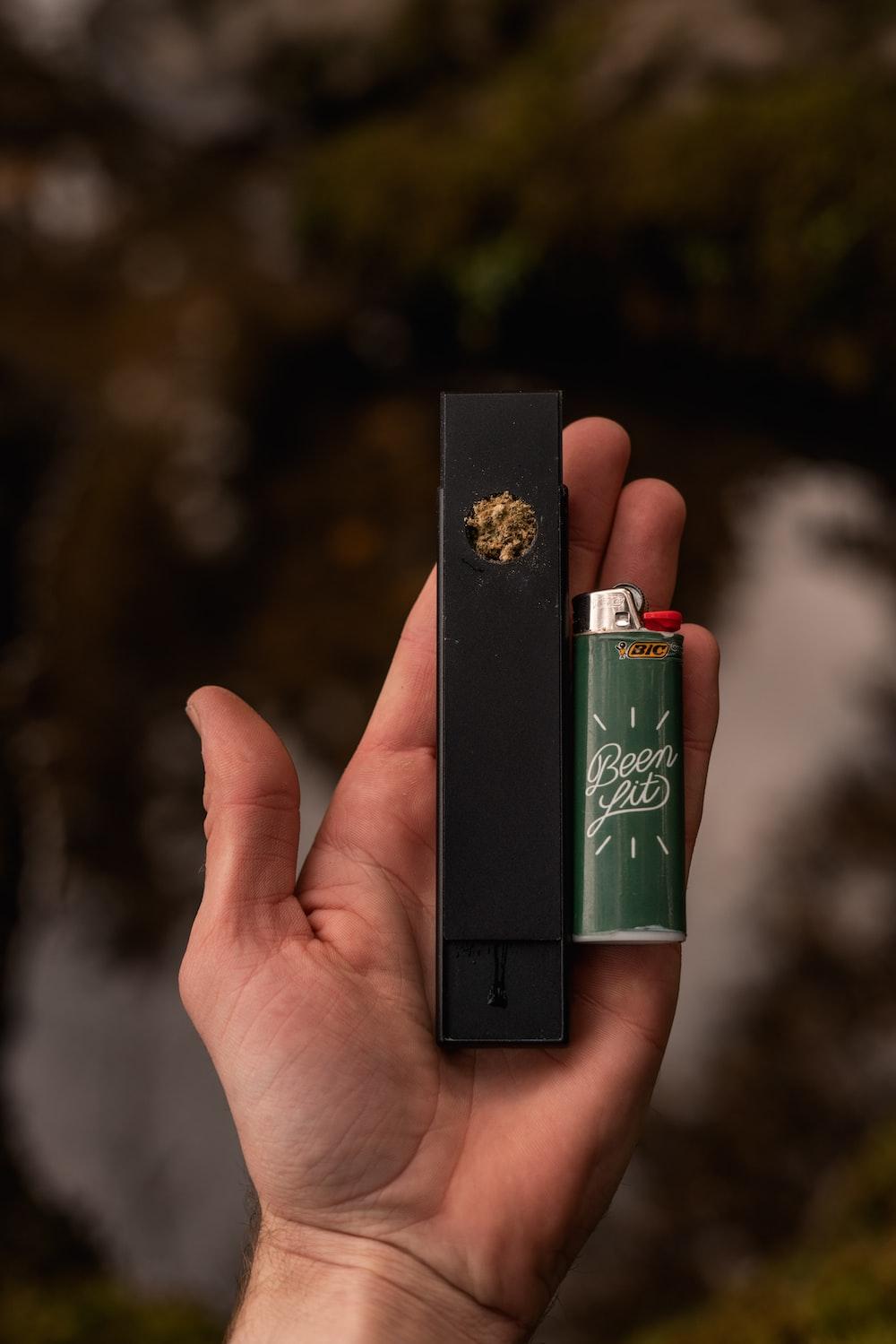 black vape and green lighter