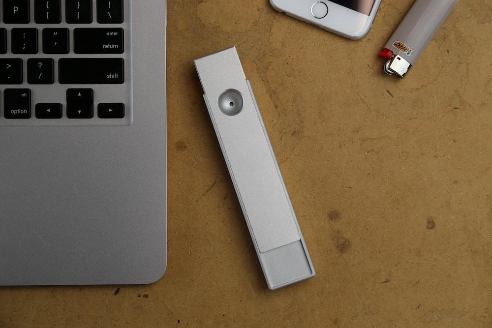white USB flash driver beside MacBook