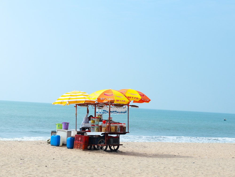 food cart on sand seashore during day