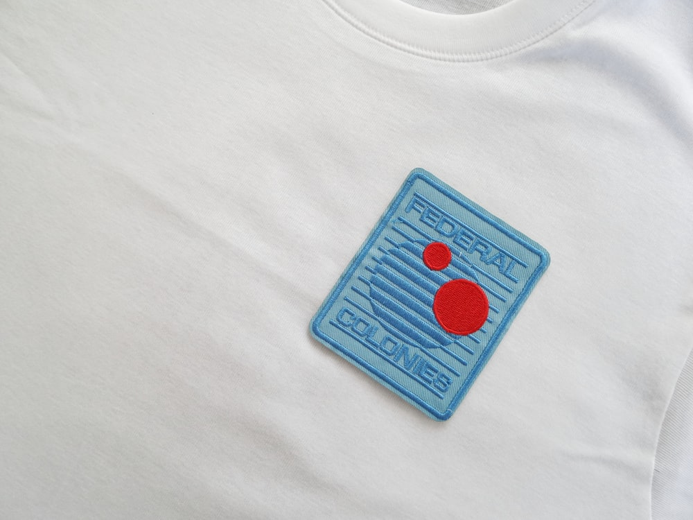 shallow focus photo of blue Federal Colones patch