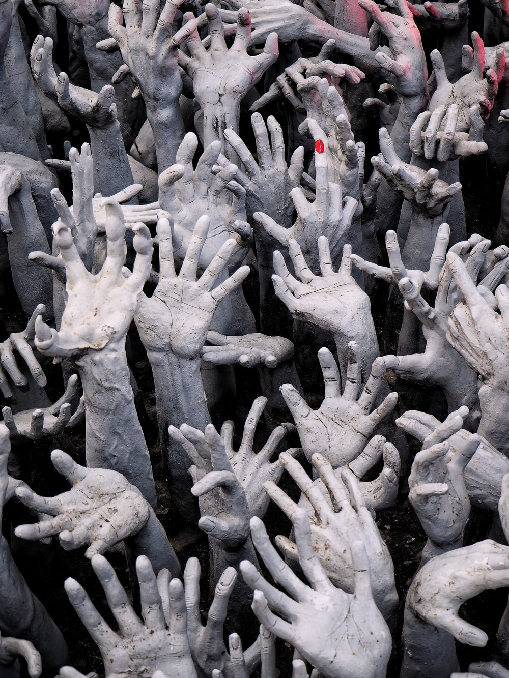 people hands holding up