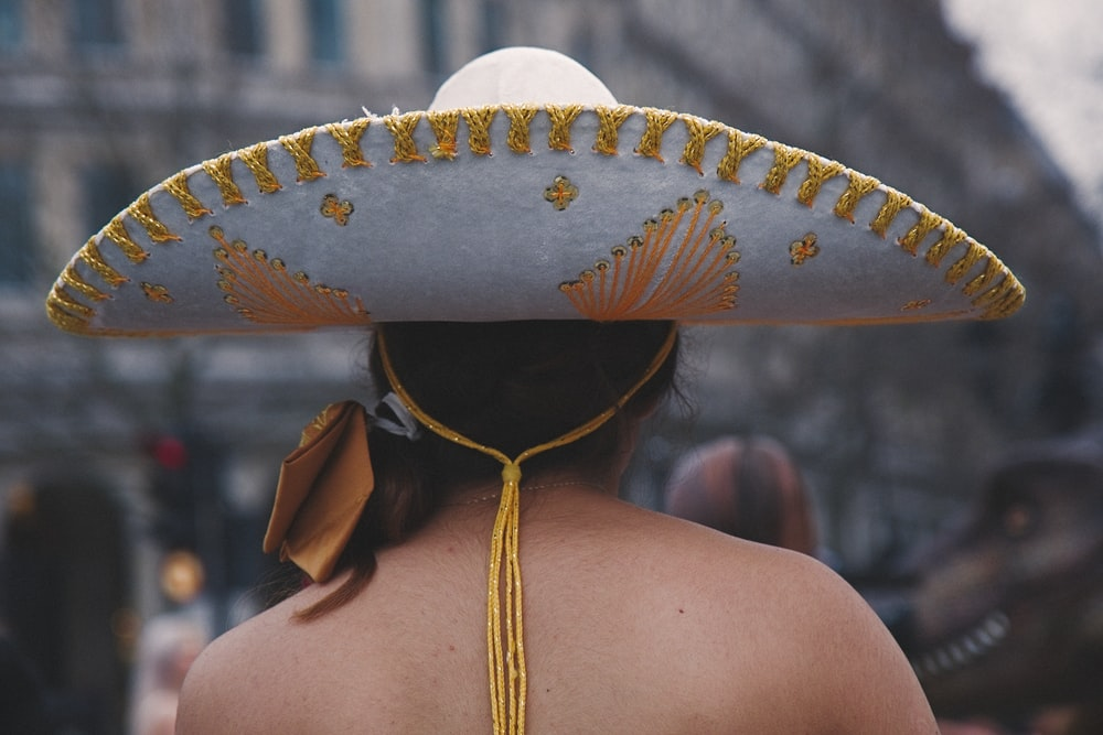 selective focus photography of woman wearing Mexican sombrero
