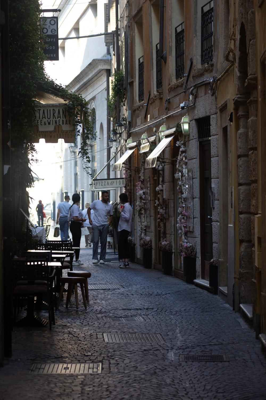 people between buildings during day