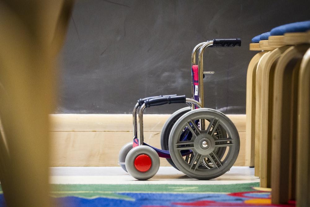 gray wheelchair beside chair