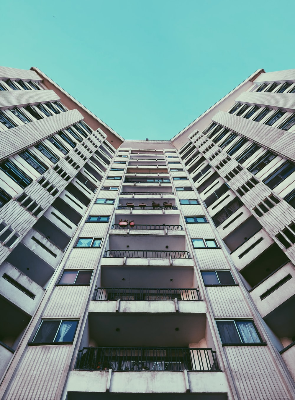high-rise building with balconies during day