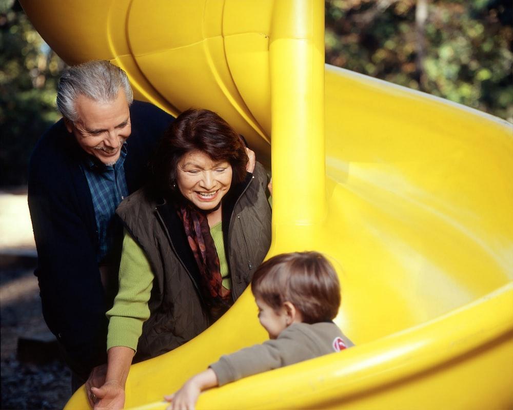 toddler sliding on yellow slide