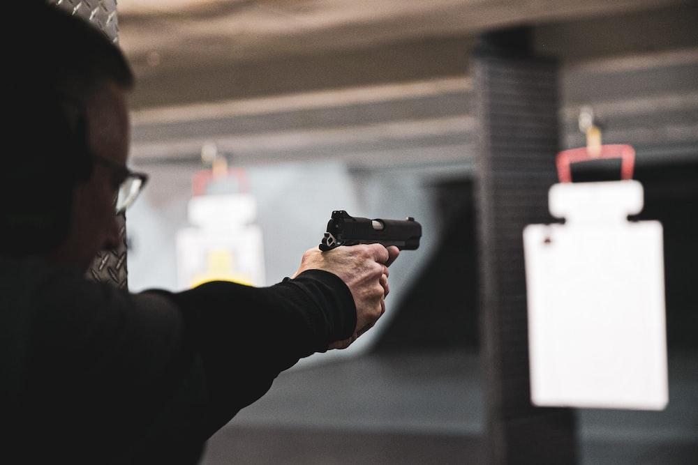 man doing practice shooting