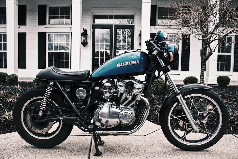 blue and black Suzuki motorcycle