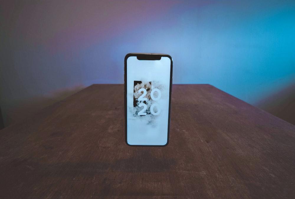 smartphone showing 2020 wallpaper