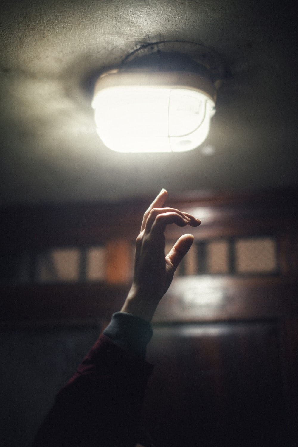 person about to touch light