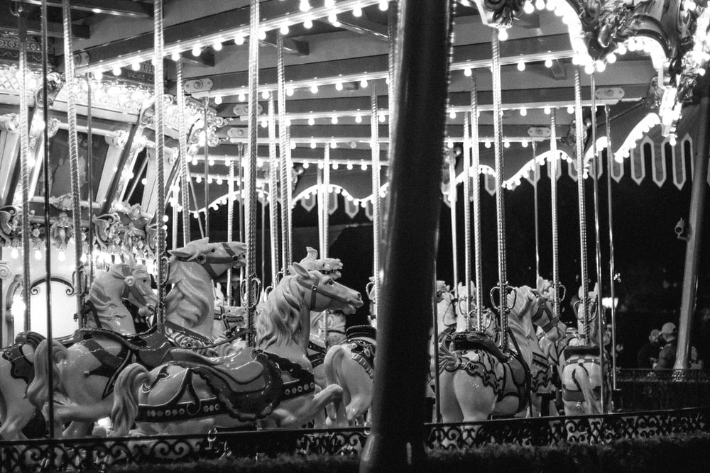 grayscale photography of carousel