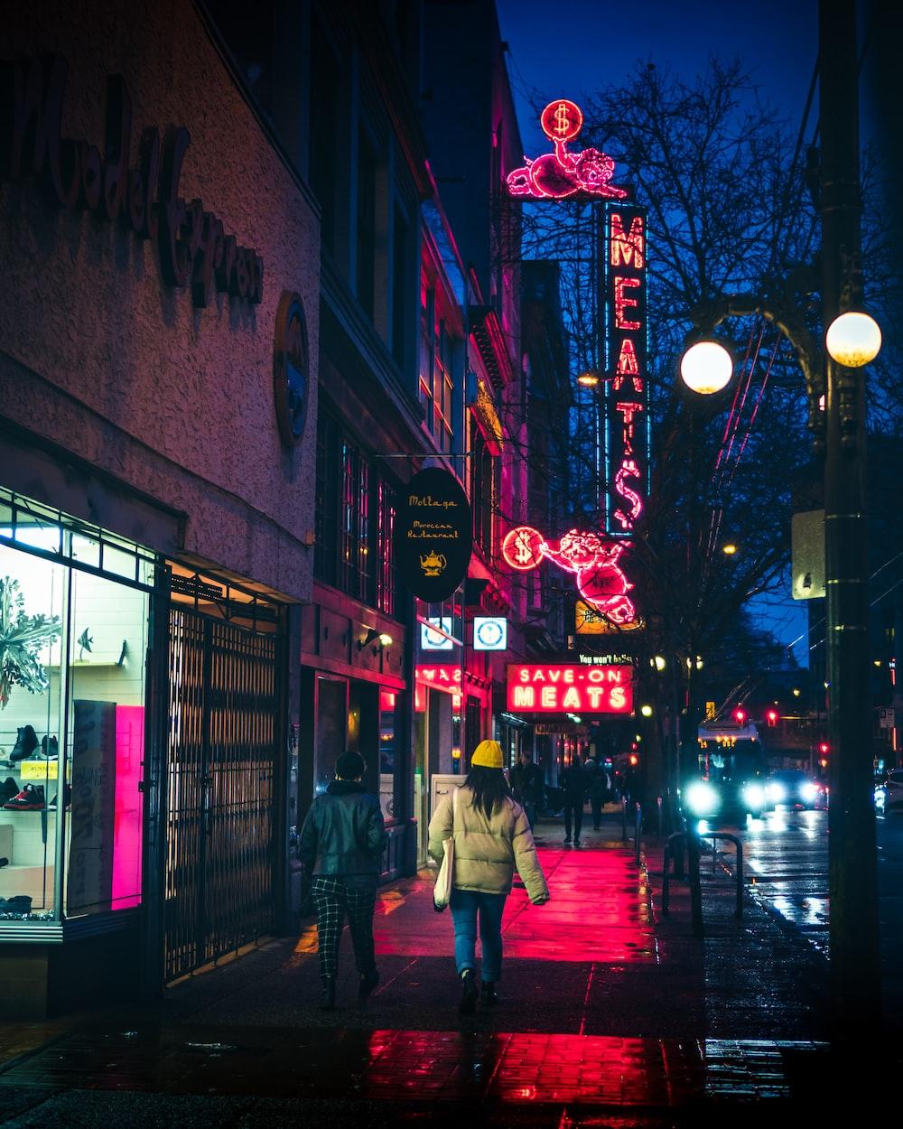 people walking on sidewalk