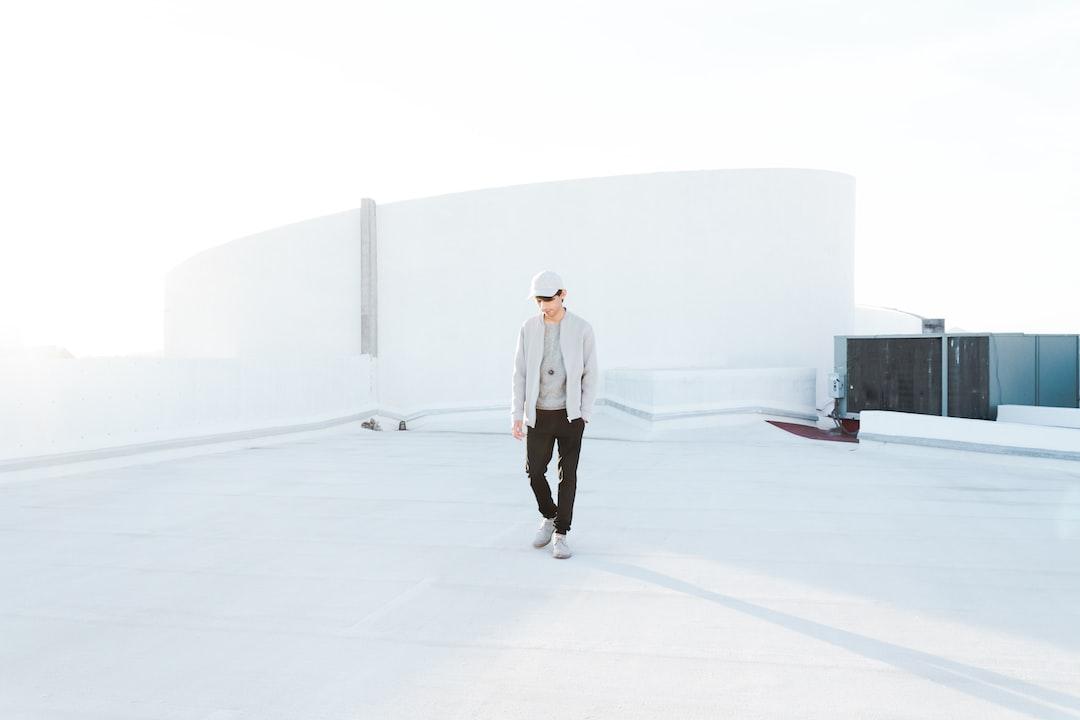 Man Standing On Rooftop - unsplash