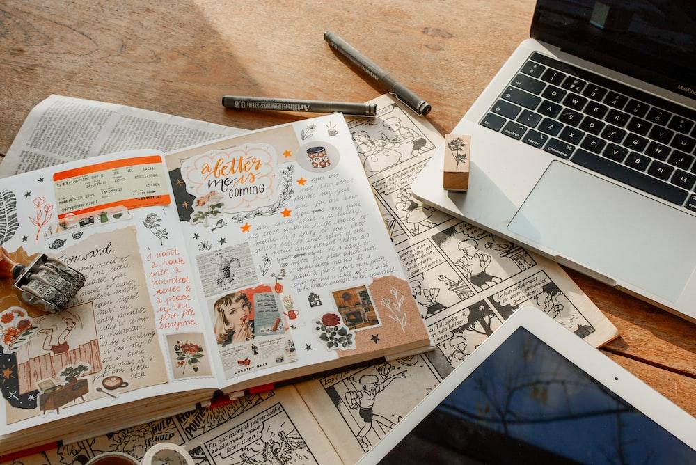 opened book beside MacBook