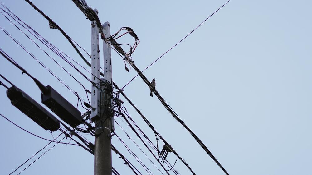 grey utility post during daytime