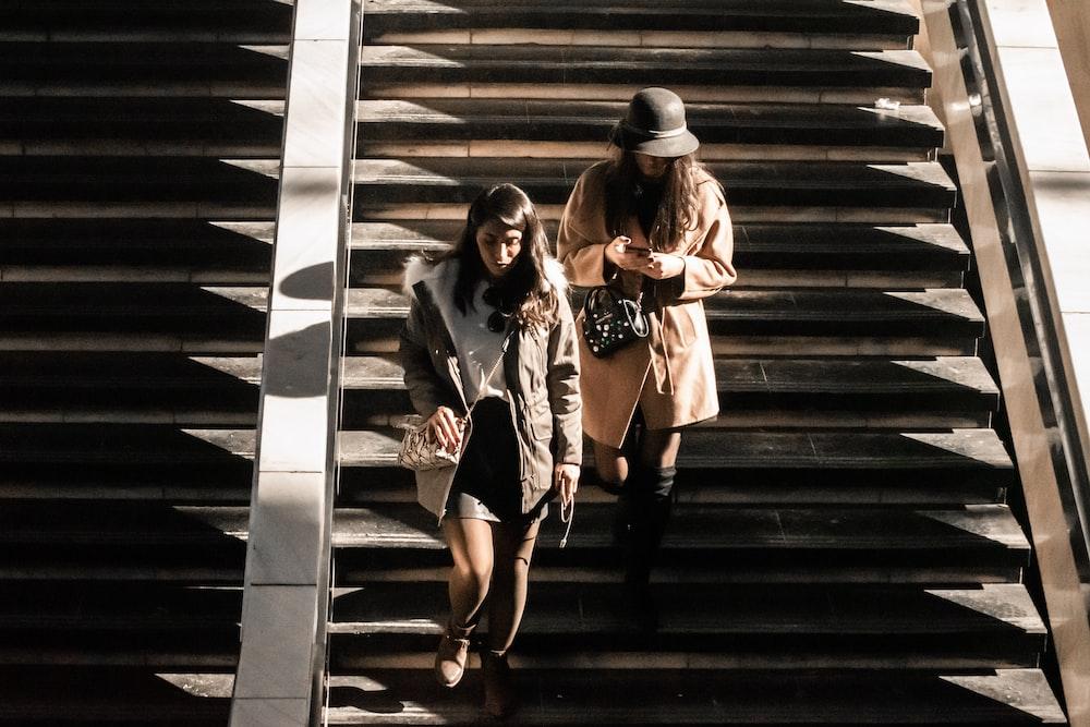 two women walking down stairs
