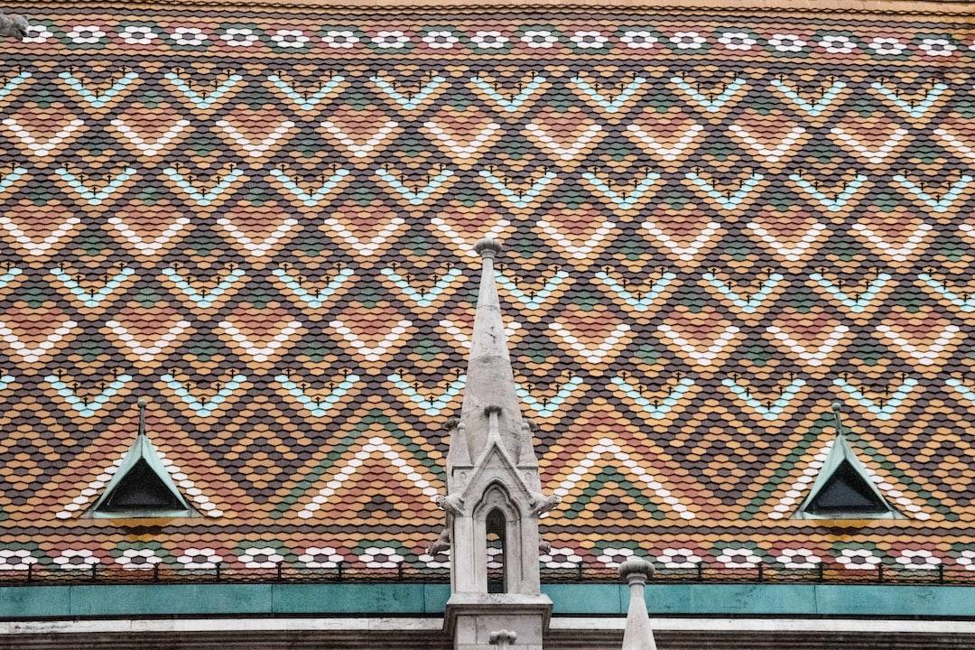 Coloured Matthias Church´s Roof In Budapest, Hungary - unsplash