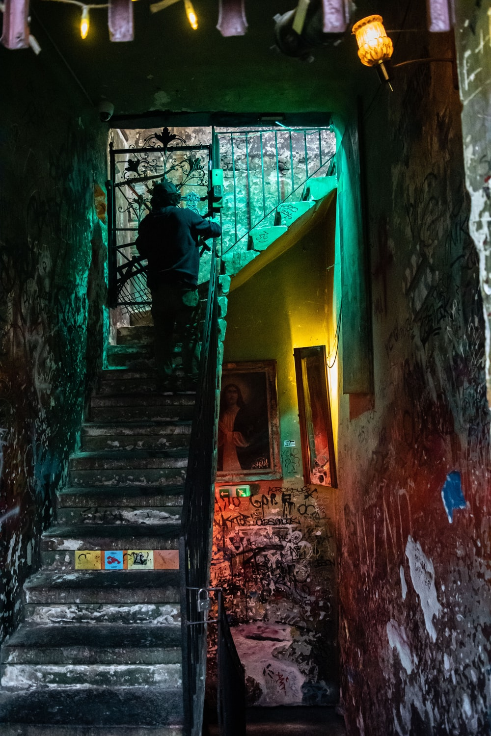 person at the staircase inside building
